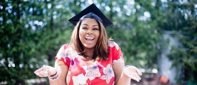 Girl wearing graduation cap outside