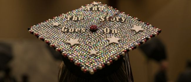 Graduation cap with text that says
