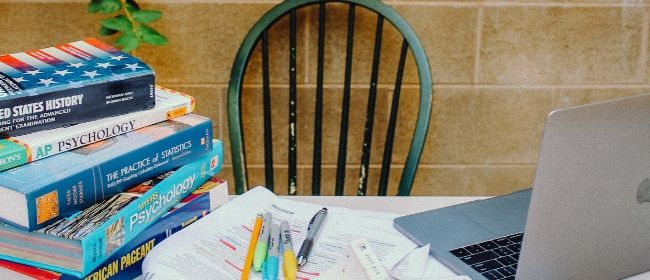 Textbooks and notes on table.