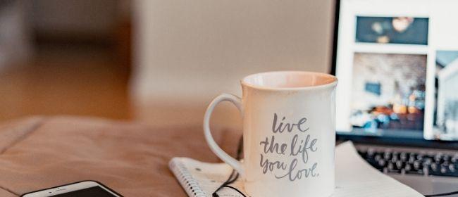 Mug and laptop on table.