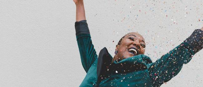 Women celebrating with confetti.